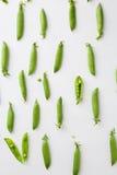 Green peas on wood background Stock Photos