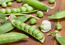 Green peas on wood board Stock Photos
