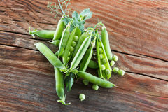 Green peas on the wooden background Stock Photos