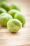 Green peas on wooden board. Stock Images