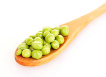 Green peas in wooden spoon Stock Photography