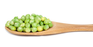 Green peas in wooden spoon Royalty Free Stock Photo