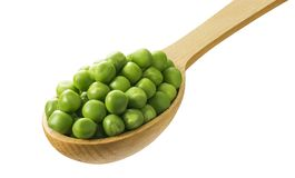 Green peas in wooden spoon isolated on white background Stock Photo