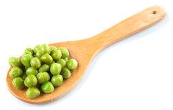 Green Peas On Wooden Spoon VIII. Green peas on wooden spoon over white background stock images
