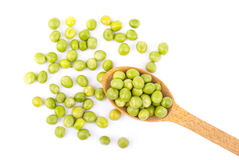 Green peas in a wooden spoon Royalty Free Stock Image