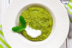 Green pease puree pudding with spinach and spices Royalty Free Stock Images