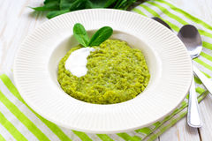 Green pease puree pudding with spinach and spices Stock Photo
