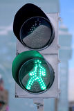 Green pedestrian lights. On the traffic lights photographed close up Stock Photography