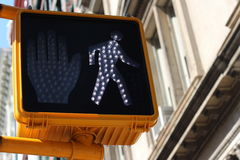 Green pedestrian signal. With a little walking man indicating that it is safe to cross the intersection or crossroads Royalty Free Stock Photos