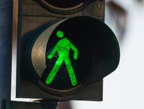 Green pedestrian traffic light. Close up of a green pedestrian traffic light Royalty Free Stock Image