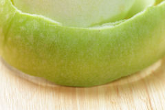 Green peeled apple closeup Stock Images