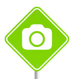 Green pemissive traffic sign with camera icon. Photography and video permissive symbol. Green traffic sign with camera icon isolated on white Royalty Free Stock Photography