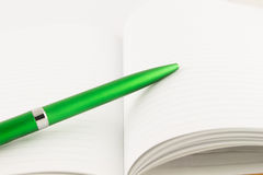 Green pen for business put on notebook Royalty Free Stock Images