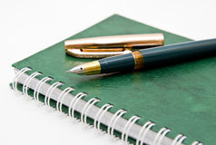 The green pen and notebook Royalty Free Stock Image