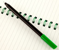 Green pen and notepad Royalty Free Stock Photo