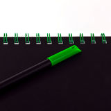 Green pen and notebook Royalty Free Stock Photos