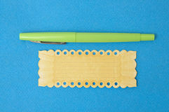 Green Pen with Ornate Yellow Labe Royalty Free Stock Image