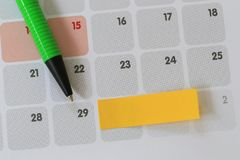 Green pen points to a Twenty-nine number of calendar and have bl. Ank yellow note paper for design concept of important day in you work Royalty Free Stock Images