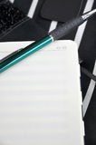 Green pen put on notes page Royalty Free Stock Images