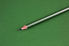 Green pencil on background Stock Photos