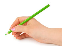 Green pencil in hand Royalty Free Stock Photography