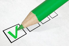 Green pencil marking check box Royalty Free Stock Photography