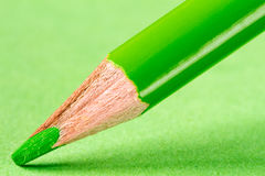 Green pencil on paper close-up Stock Photography