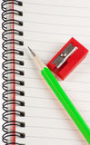 Green pencil Red Sharpener Stock Images