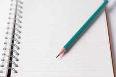 Green pencil on ring book. Royalty Free Stock Photos