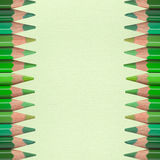 Green pencils on paper texture Stock Image