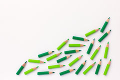 Green pencils in progressive upward trend curve Stock Photography