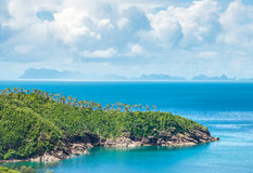 Green peninsula covered with palm trees in Thailand Stock Images