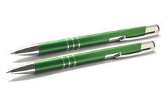 Green pens. Green ball-point pens over white stock photos
