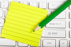 Green pensil and keyboard Royalty Free Stock Photography