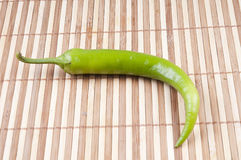 Green pepper. On the bamboo background Royalty Free Stock Photos