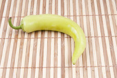 Green pepper. On the bamboo background Stock Photos