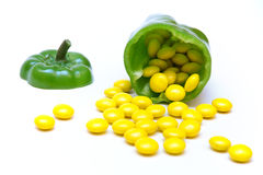 Green pepper with candy. Green pepper fruit filled with yellow candy royalty free stock photography