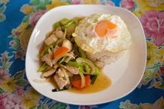 Green pepper chicken egg stirfry. Fresh prepared asian hot green pepper, vegetables, chicken stirfry and fried egg on jasmine rice. Traditional thai cuisine made Stock Photo