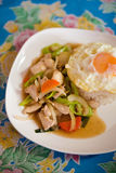 Green pepper chicken egg stirfry. Fresh prepared asian hot green pepper, vegetables, chicken stirfry and fried egg on jasmine rice. Traditional thai cuisine made Stock Photos