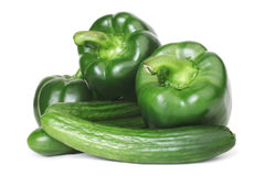 Green pepper and cucumber. Fresh vegetables isolated on white Royalty Free Stock Photos