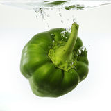 Green Pepper dropped into water Stock Image