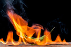 Green pepper with flame Stock Photography