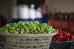 Green Pepper in a basket from Ghana Market stock photos