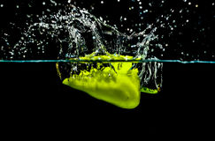Green pepper making water splash Stock Photo