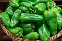 Green pepper. In market basket Stock Photography