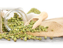 Green pepper. Photo of glass spicebox full of green pepper on burlap with white space Stock Photos