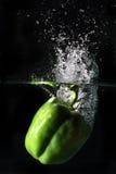 Green pepper splash Stock Images