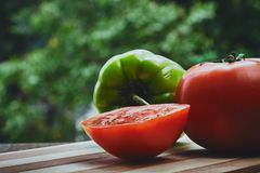 Green pepper and tomato Stock Images