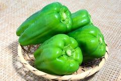 Green pepper went into a bamboo basket. Green pepper went into a small bamboo basket Royalty Free Stock Photos