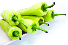 Green pepper on white plate Royalty Free Stock Photography